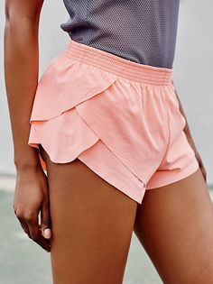 Go With The Flow Short | Hit the ground running in these breezy activewear shorts, featuring flutter overlay detail for easy range of motion. Elastic waistband and easy-to-wear fabrication makes for an effortless fit.
