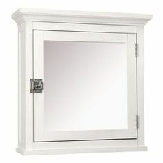 """Wall-mounted medicine cabinet with a white frame and single interior shelf.    Product: Medicine cabinet    Construction Material: MDF and mirrored glass    Color: White   Features:     Door with mirror and lock handle      One shelf behind mirror       Dimensions: 18.5"""" H x 18.25"""" W x 5.5"""" D         Note: Assembly required"""