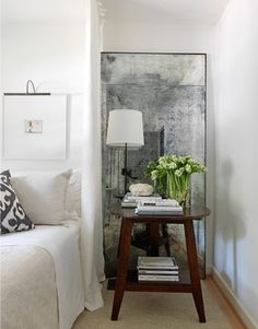 Whether it's behind a candle, a pendant light, or a bedside lamp, a mirror will help to maximize the light's reach while creating an almost magical effect.