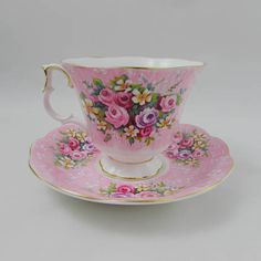 Beautiful bone china tea cup and saucer set made by Royal Albert. Pattern is Lyric in the Festival Series. Tea cup and saucer are pink with small flowers. Gold trimming on cup and saucer edges. Excellent condition (see photos). The markings read: Royal Albert Bone China England Festival