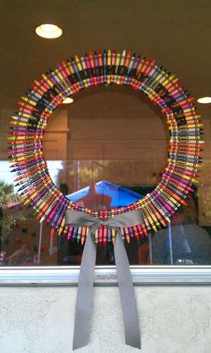 PARTY INSPIRATION: Add tons of color to the house with an easy DIY crayon wreath. See how to make it here. >>