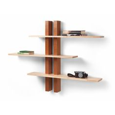 These shelves make an ideal wall feature. Self-assembled, each shelf can be moved horizontally and positioned individually according to your taste or space requirements. Pictured in cherry with maple shelves.  Height 100cm, shelf width 100cm (max overall width 150cm) and shelf depth 17 cm.  Standard sizes are specified. However, these shelves can be made to a custom size, incorporating more or fewer shelves, and from a timber of your choice. Please just ask!  Supplied with fixings and…