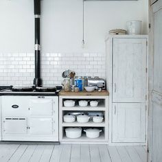 Or maybe I need a WHITE set of Le Creuset...plus a matching Aga range cooker.