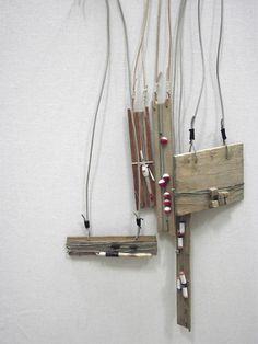 Fishing Line Reel Necklaces from Swarm - I would hang on the wall too!
