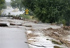Flooding near Left Hand Canyon, south of Lyons, CO. A road is washed out by a torrent of water following overnight flash flooding near Left Hand Canyon, south of Lyons, Colo., Thursday, Sept 12, 2013. Widespread high waters are keeping search and rescue teams from reaching stranded residents in Lyons and nearby mountain communities as heavy rains hammered northern Colorado. (AP Photo/Brennan Linsley)