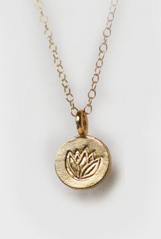 Lotus Charm Necklace   MinimalVS on Etsy - LOVE THAT THIS GORGEOUS CHARM, HAS A LOTUS FLOWER ENGRAVED ON IT, I BELIEVE THEY BRING LUCK!!