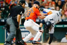 TAGGED OUT:   Lance McCullers Jr. (43) of the Houston Astros tags out Austin Romine (27) of the New York Yankees as he attempts to score on a wild pitch in the fourth inning as hoke plate umpire Mark Wegner (14) makes the call at Minute Maid Park on June 30, in Houston, Texas.