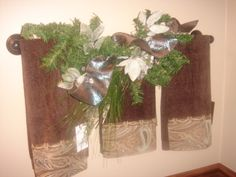 Towel bar garland decorated for Christmas