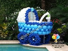 Baby Carriage Balloon sculpture - Baby Shower decoration, 6ft tall - Available in any color. Extreme Decorations Miami, FL 786-663-8198