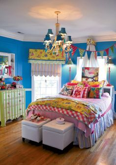 blue walls, green & white striped dresser, yellow and pink bedding & window treatments: I do love color -- kind of think you can't have too much of it in a kid's room.