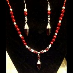 """If you LOVE red then you will fall in love with this set! Crafted with deep red pearl-like glass beads, silver accent beads, decorative red & silver glass beads with deep red drop beads individually hand-wrapped in non-tarnish silver craft wire.    If you live in Columbia, SC or close surrounding areas enter discount code COLA1 for FREE SHIPPING! Then message me or email me at beaded4belles@gmail.com to set up a """"Meet & Deliver"""".   Shop this product here: spreesy.com/beadedforbelles/6   Shop…"""