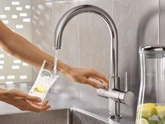 GROHE Blue Pure is the alternative for purified, still water straight from your kitchen faucet. Sink Water Filter, Water Faucet, Water Tap, Tub Faucet, Habitat For Humanity, Grohe Blue, Grohe Bathroom Faucets, Power Shower, Black Kitchen Faucets