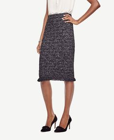 """Our new twist on tweed pairs a slim pencil silhouette with a playfully fringed hem. Encased elastic waistband. 25 1/2"""" front length; 26"""" back length."""