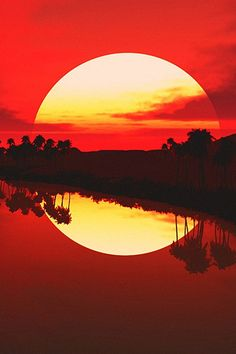 Stunning sunset reflection. All warm tones - orange, gold and red. The land growing bigger across the page. Great separation with land between real and reflection. The land is not exactly in the middle of the picture which gives it an original feel.