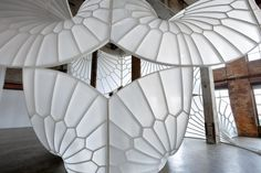 """Texture and Pattern // A beautiful white sculptural installation carved from foam and wrapped with layers of fiberglass and epoxy resin. Designed by David Henderson, titled """"A History of Aviation""""» CONTEMPORIST"""