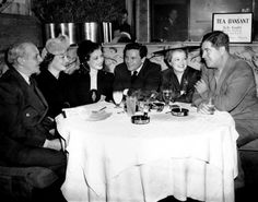 Walter Winchell, Myrna Loy, Loretta Young, John Garfield, Janet Gaynor and Quentin Reynolds at the Stork Club preparing for a WWII Navy Relief Show, 1942
