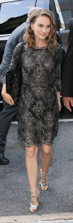 Who made Natalie Portman's silver sandals, long sleeve top, and black tote handbag?