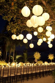 Night reception with lanterns and long table setting.  Wedding Reception Ideas You'll Love. #Decor #Celebstylewed. @Jason Stocks-Young Stocks-Young Jones Style Weddings