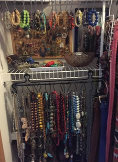 Necklaces are all on the bottom organized by colour, bracelets on top and my little glass trays hold bangles, brooches and such!