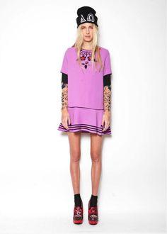embellishment top worn upon tattoo top and matching varsity skirt
