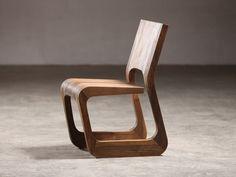 Sled base walnut chair Steek Collection by Artisan   design Karim Rashid