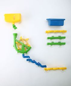 Copy with PVC... No longer will little feet run from the sound of running water! Bath time becomes creative playtime with this set featuring chutes, a water wheel, reservoir tank and pouring cup for endless construction possibilities.