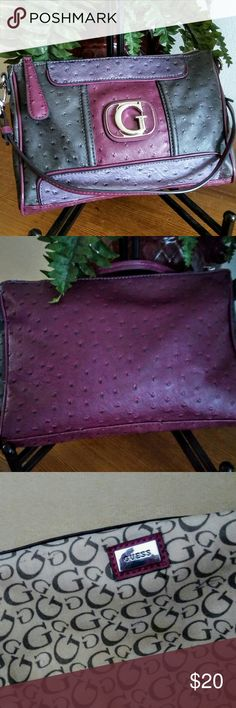 Guess faux ostrich in rich colors. Rich plum, purple and grey colors make this convertable clutch a standout.  Used twice Very slight stain at botom of the lining. Bags Clutches & Wristlets