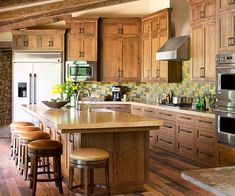 Modern meets rustic in this gorgeous kitchen. More space-smart kitchens:  http://www.bhg.com/kitchen/styles/dream-kitchens/small-dream-kitchens/?socsrc=bhgpin081713woodkitchen=7