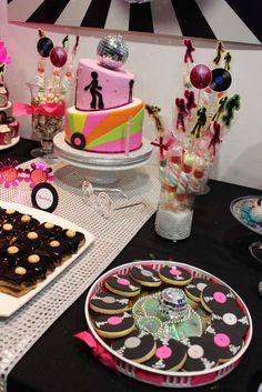 Vinyl record cookies and treats at a disco birthday party!  See more party planning ideas at CatchMyParty.com!