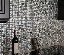 Black Lip Mother of Pearl backsplash  in Floridian Home... wow