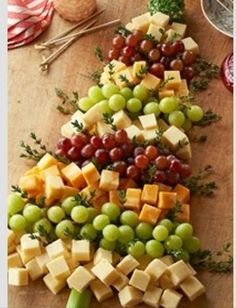 Decorative Christmas Foods: Christmas tree made of cheese & grapes