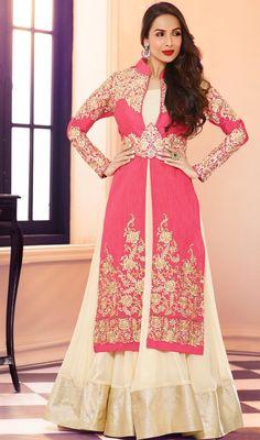 Keep your admirers spellbound like Malaika Arora Khan arrayed in this cream and rose pink georgette lehenga choli dress. The wonderful dress creates a dramatic canvas with astounding lace, resham and stones work. #MalaikaArorakKhanShararaStyleSuit