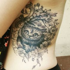 My Cheshire Cat tattoo. Love this thing! #blackandwhitetattoos #cheshirecatforthewin