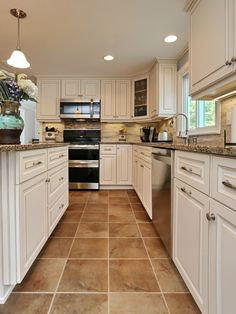 Beautiful before & after photos of white kitchen with quartz countertops!