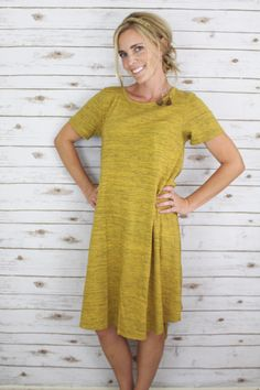 the LuLaRoe Carly swing dress!  its higher in the front and lower in the back.  And its to die for comfort!  add this to your wardrobe today!  click on my page to come shop! https://www.facebook.com/groups/LuLaRoeTrishaAdcock/
