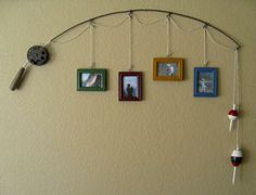 Recycle a fishing rod and hang photo frames. I have a perfect use for this :-D