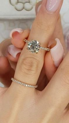 For the ring that's already on her finger - nefn Dream Engagement Rings, Engagement Ring Cuts, Rose Gold Engagement Ring, Engagement Nails, Most Popular Engagement Rings, Designer Engagement Rings, Simple Elegant Engagement Rings, Inexpensive Engagement Rings, Tiffany Engagement