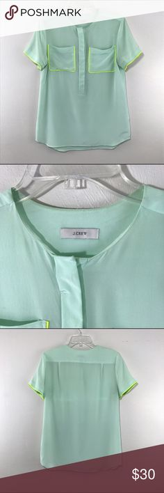 "J. Crew Silk Top Brand: J. Crew Description: Pajama style top  Color: Mint green with lime green trim Condition: Perfect condition - no known flaws Material: 100% Silk Size: No size tag - estimate to be a size small Chest Measurement: 18"" across laying flat Length: 26"" Notes: Rounded hem J. Crew Tops Blouses"
