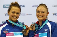 Tonia Couch and Sarah Barrow of Great Britain celebrate on the podium with their bronze medals after taking third place in the Women's synchronised 10m platform final. (Getty) Add Around The Rings on www.Twitter.com/AroundTheRings & www.Facebook.com/AroundTheRings for the latest info on the Olympics.