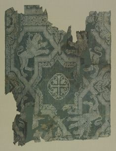 Fragment: Eight-Pointed Star with Griffins, 900s Syria, 10th century weft-patterned tabby weave, silk, Overall: 40.30 x 30.50 cm (15 13/16 x 12 inches).