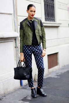 break up a tough girl moto jacket and black chunky boots with a pair of feminine printed pants