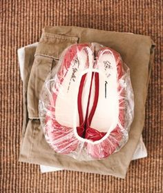 A giveaway shower cap becomes the perfect wrapper for shoes when traveling, preventing them from dirtying clothes packed in your suitcase.
