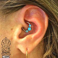 Daith Piercing with an ANATOMETAL forward facing circular barbell with gem bezel…