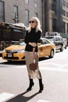 long skirt over long tall boots