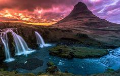 The Kirkjufell mountain and waterfall near Grundarfjordur in twilight, Snaefellsnes Peninsula, in western Iceland.--- Kirkjufell and Kirkjufellfoss in foreground, a midnightsun in the back.