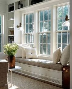 Triple double hung windows with window seat and bookcases