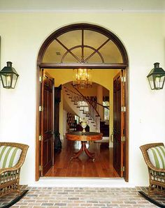 LOVE this entry!  Lighting, stucco, double doors, covered porch!