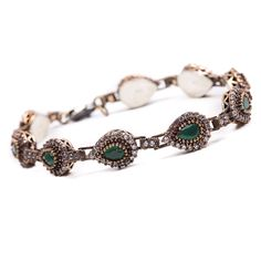 Pulseira em prata 925 com detalhes em cobre, jade na cor esmeralda, com cravação de zircônias brancas. Semijoia.