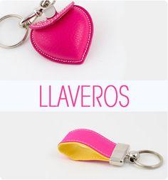 Key Ring handcrafted fabric cape pink with brown leather trim. Llavero fabricado artesanalmente en tela capote fuxia y ribete de piel.