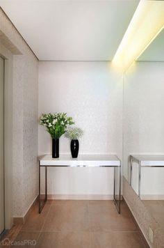 Hall de entrada projetado por MADI ARQUITETURA E DESIGN.
